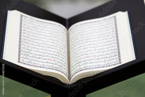 Fotografiet Islamic holy book Quran in mosque opened for reading and prayer