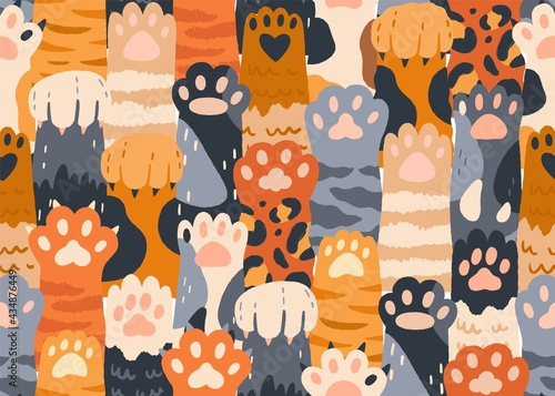 Seamless pattern with cute cat paws raised up together Fototapeta