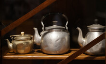 Aluminum Kettle On A Shelf In The Kitchen