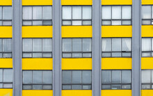 Yellow And Gray Building Background With Windows. Architecture Exterior.