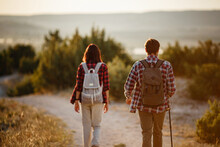 Portrait Of Happy Young Couple Having Fun On Their Hiking Trip. Caucasian And Asian Hiker Couple Enjoying Themselves On Summer Vacation.