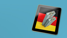 Generic Tablet Showing 100 Dollar Banknotes On German National Flag. Copy Space On The Left Side. 3D Rendering