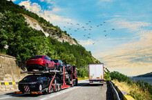 Car Carrier Transporter Truck On Road. Auto Vehicles Hauler On Driveway. European Transport Logistics At Haulage Work Transportation. No Logo,brand.