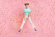 Full Body Photo Of Cheerful Pretty Person Jumping Toothy Smile Wear Teal Outfit Isolated On Pink Color Background