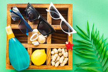 Summer Background Beach Mood Tropical Leaf Travel Accessories Vacation Ocean Sea, Summer Sunscreen Bottle Of Lotion, Sun Glasses, Seashells, Lemon Positive Mood Top View