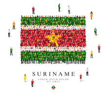 A Large Group Of People Are Standing In Green, Yellow, White And Red Robes, Symbolizing The Flag Of Suriname.