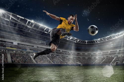 Fototapeta Professional male football, soccer player on stadium background