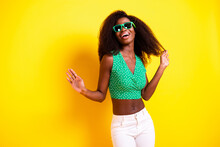 Photo Portrait Of Curly Girl Dancing Overjoyed Laughing Wearing Dotted Top Isolated On Vivid Yellow Color Background Copyspace