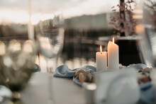 Luxury Romantic Candlelight Dinner Table Setup For Couple In Ocean View Restaurant On Valentine Or Wedding Evening