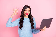 Photo Of Cute Promoter Girl Hold Netbook Show Okey Wear Blue Pullover Isolated Pink Color Background