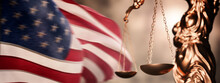Law And Order Concept. Statue Of Lady Justice With Scales Of Justice With US Flag Background. Lawyer Or Judge Concept.