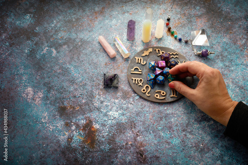 zodiac horoscope symbol with fortune-teller hands and healing crystals on rustic Fotobehang