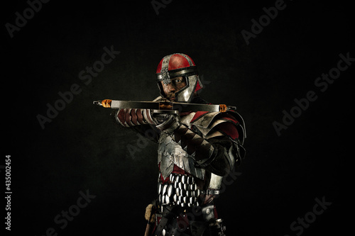 Valokuva Portrait of a medieval fighter holding a crossbow in his hands