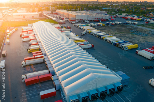 Fotografering Logistics park with warehouse and loading hub