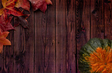 Pumpkin And Autumn Leaves On Wooden Background Table