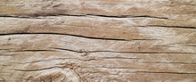 Old Aged Timber In A Barn Or Old House. Old Dark Rough Wood Floor Or Surface With Splinters And Knots. Background With Flooring Or Boards With Wood Grain.