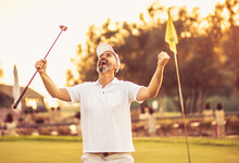 The Senior Golfer Rejoiced At His Victory. Man On Golf Filed.
