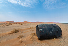 Carelessly Disposed Of A Bin At The Roadside In The Desert On The Way Between Sesriem And Sossusvlei, Namibia, Africa.