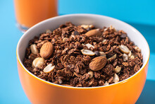 Granola With Almond And Peanut In Orange Bowl