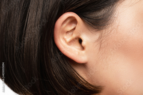 Closeup view of female ear Fototapet