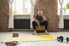 Exhausted Elderly Man Resting After His Fitness Workout