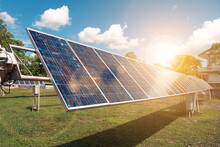 Solar Power Alternative Eco Environment Friendly Sustainable Renewable Energy Resource Concept, Solar Panel Cell Farm Photovoltaic Power Plant Gathering Heat From Sun's Energy Sunset Background.