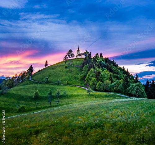 Fotografia Sveti Jakob hill with a church on top, Central Slovenia region