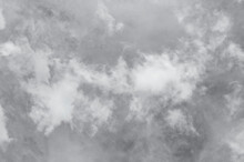 Blue Sky With Dark Black, Gray And White Clouds With Background Texture