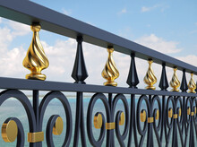 Forged Detail. 3D Render. Iron Railing. Metal Work. Forging. Balcony Design. Terrace. Luxury Handrails. Black And Gold Decor. Iron Fence. Blacksmithing. Architectural Elements. Bokeh. Blur. Sea View.