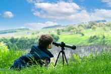 Little Boy Looking In Spyglass On Sunny Field Countryside