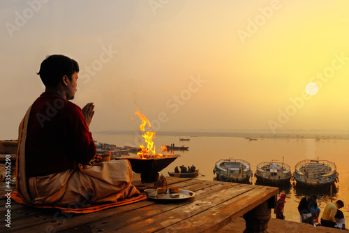 Fotografie, Obraz An Unidentified Hindu Brahman monk meditates on the ghat stairs of holy Ganges r