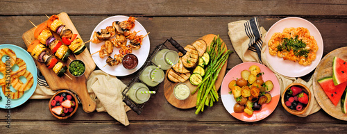 Photographie Healthy plant based summer bbq table scene