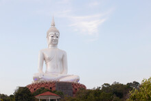 Big White Buddha Statue On Mountain In Wat Roi Phra Phutthabat Phu Manorom For Thai People And Foreigner Travelers Travel Visit And Respect Praying At Mukdahan National Park In Mukdahan, Thailand