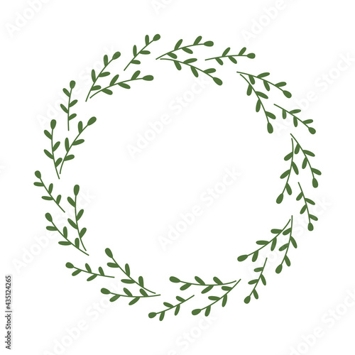 Fototapeta A simple round wreath of branches with small leaves