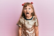 Little Caucasian Girl Kid Wearing Festive Sequins Dress Sticking Tongue Out Happy With Funny Expression. Emotion Concept.