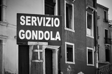 Gondola Service Sign By Canal In Venice