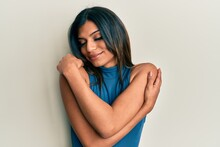 Young Latin Transsexual Transgender Woman Wearing Casual Clothes Hugging Oneself Happy And Positive, Smiling Confident. Self Love And Self Care