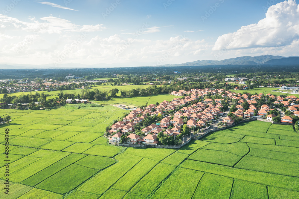 Land or landscape of green field in aerial view. Include agriculture farm, house building, village. That real estate or property. Plot of land for housing subdivision, development, sale or investment.