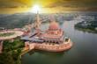 Leinwandbild Motiv Aerial View Of Putra Mosque with Putrajaya City Centre with Lake at sunset in Putrajaya, Malaysia.