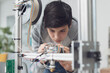 Leinwandbild Motiv Young student using a 3D printer in the lab