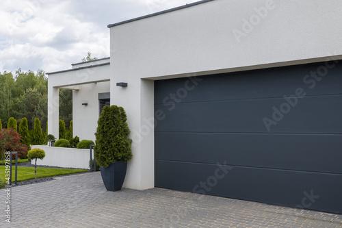 Photo View of the garage door in an elegant suburban home