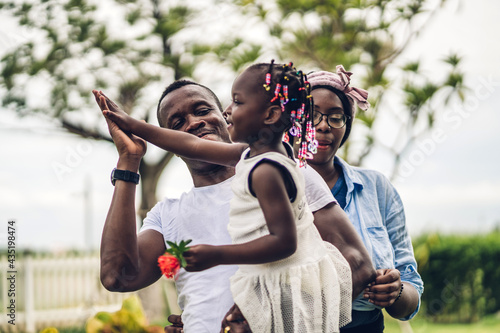 Fotografiet Portrait of enjoy happy love black family african american father and mother wit