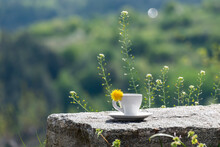 Coffee Cup Or Mug On Natural Stone Table Against Blurred Green Background Of Mountains. Enjoy Fresh Summer Morning In Nature In Mountains While Travel, Vacation Or Weekend Getaway