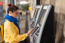 Close-up Of A Woman Paying At A Self-service Machine Using A Contactless Phone Payment