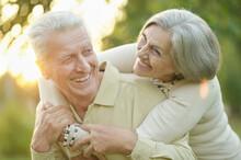 Smiling Senior Couple  In Autumn  Park