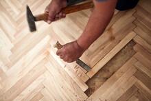 Repairman Restoring Old Parquet Hardwood Floor.