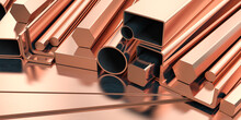 Copper Tubes And Different Profiles In Warehouse Background. Different Copper Metal Rolled Products.