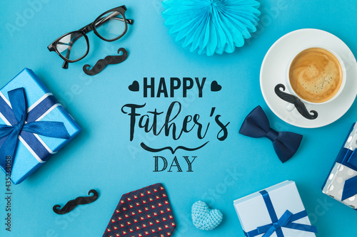 Obraz na plátně Happy Fathers day concept with coffee cup,  tie bow and gift box on blue backgro