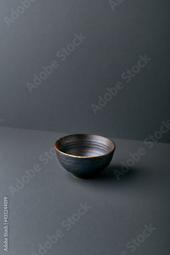 Traditional ceramic bowl on gray background Fototapet