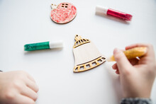 Wooden Christmas Tree For Coloring, Paint And Gift Box On White Background. Art Project. DIY Concept.The Idea Of Creating Christmas Gift With Your Own Hands.Little Child Is Decorating Wooden Toys